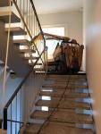 Brokk kiipeää portaita